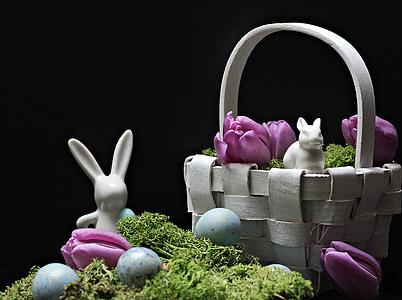 white rabbit ceramic figurine beside woven basket
