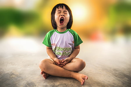 toddler wearing white and green t-shirt