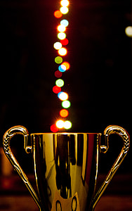 gold trophy figure with bokeh effect