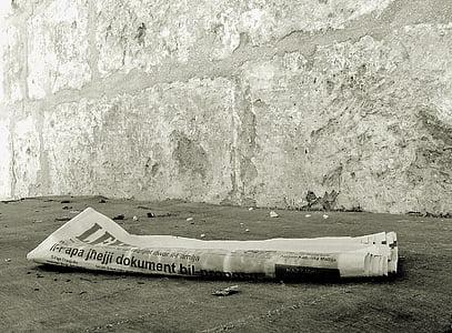 newspaper on gray concrete floor