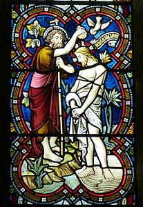 stained glass of John Baptist Jesus Christ