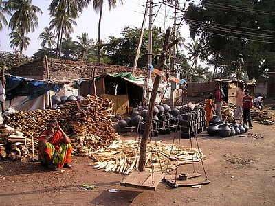 firewood and clay pot piled outside the house
