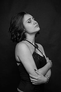 grayscale photography of woman wearing spaghetti-strap top