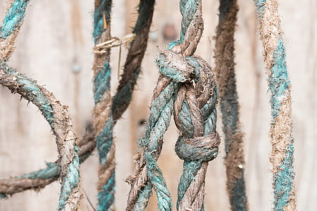 close up photo of teal and brown rope