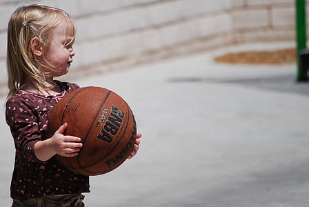girl carrying basketball