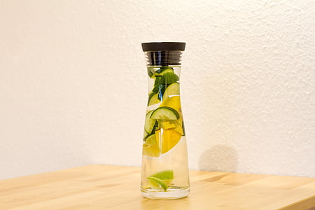 clear glass bottle with water and citrus