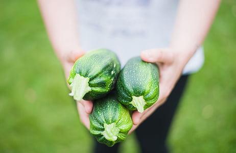 three green cucumbers