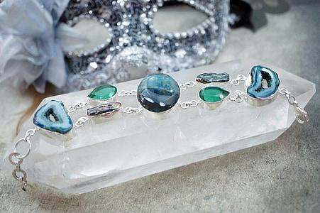 assorted gemstones on jewelry