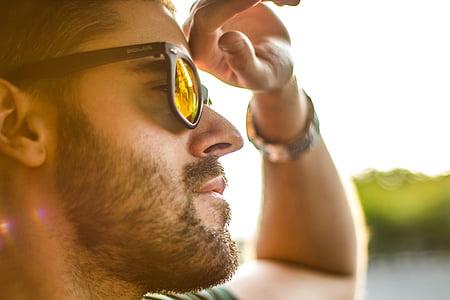 man wearing black sunglasses at daytime