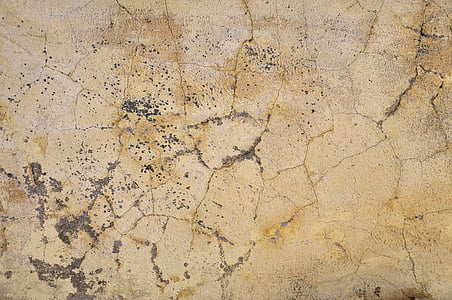 cracked beige painted surface