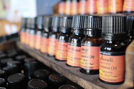 selective focus photographyof oil bottle