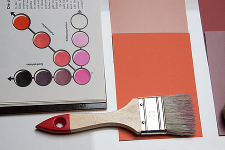 brown and red handled paint brush