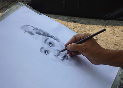 person doing portrait sketch