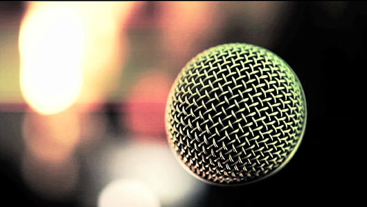selective focus photography of condenser microphone with bokeh background