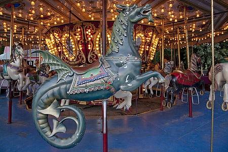 closeup photo of seahorse carousel