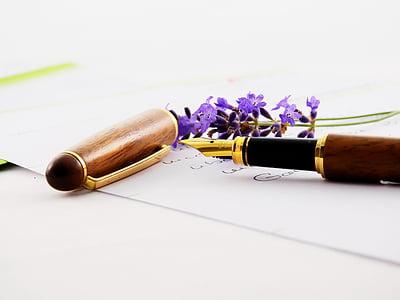 brown fountain pen on white paper sheet