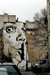 man with finger on lips building wall paint