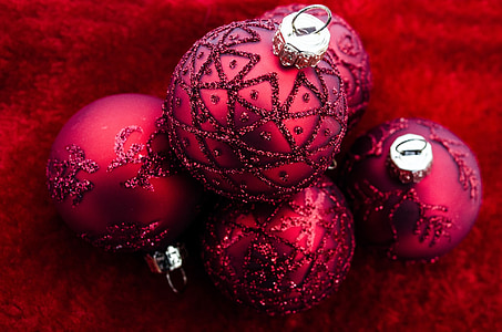 close shot of five red ornaments
