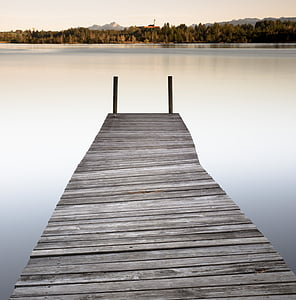 brown dock with body of water
