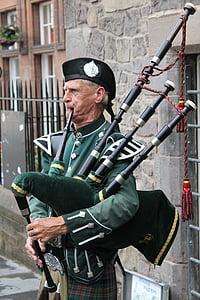 man playing musical instrument during daytime