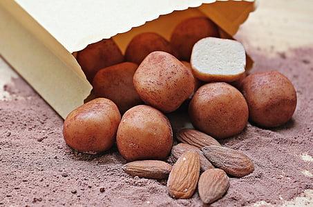 almonds on chocolate powder