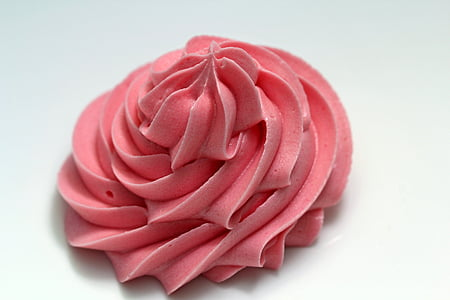 pink icing on top of white surface