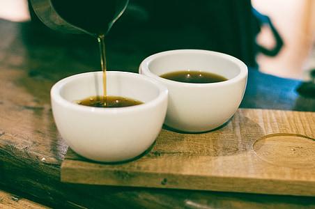 two white ceramic tea cups