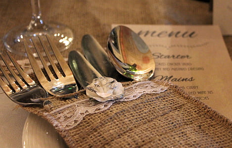 gray spoon, fork, and knife ins brown cloth