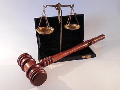 brown wooden judge mallet beside brown balance scale