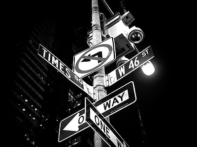 grayscale photo of street signs