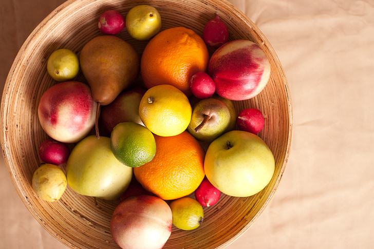bunch of fruits on brown bowl