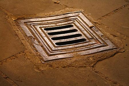 closeup photo of gray drainage