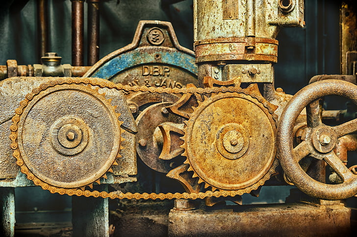 photo of brown mechanical equipment with crank