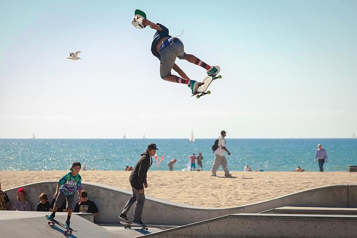 man flipping his skateboard