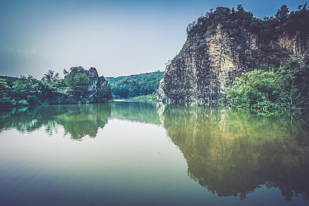 island surrounded by calm body of water