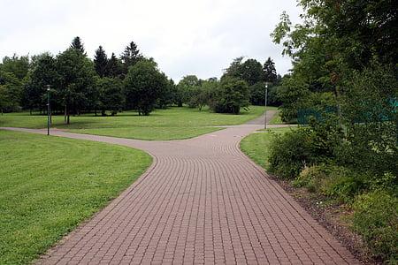 gray concrete pathway at daytime