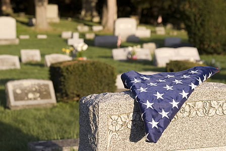 blue country flag on gray tomb