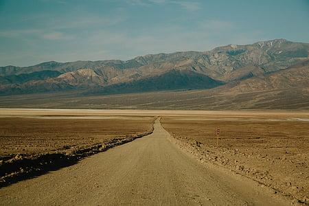 landscape photography of road towards mountain range
