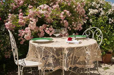 round white table with beige lace table mat at daytime