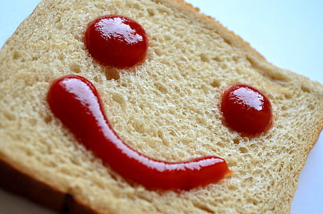wheat bread with hammy emoji ketchup decor