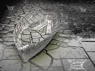 gray clinker boat on concrete pavement