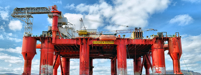 architectural photography of red oil rig