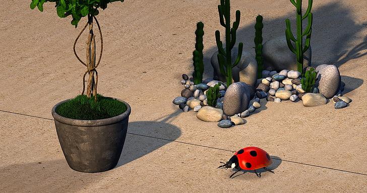 toy ladybug near green cactus plants
