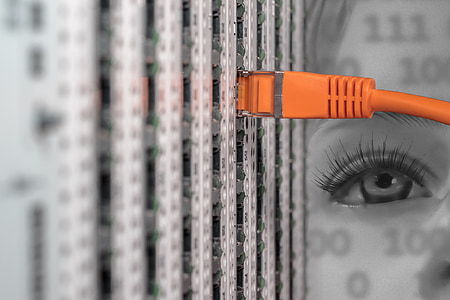 selective color photo of plugged-in orange modem cable