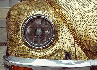 gold Volkswagen Beetle
