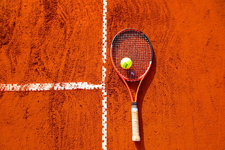 black and red tennis racket with green tennis ball