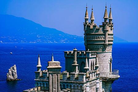gray castle near sea at daytime