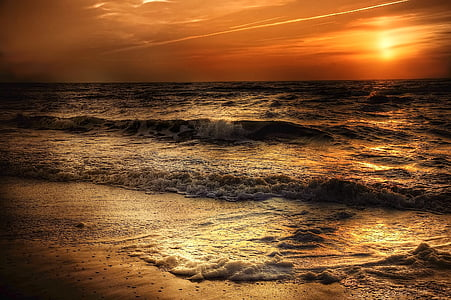 beach and sea waves during sunset