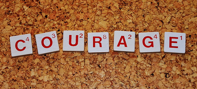 photography of Courage scrabble tiles