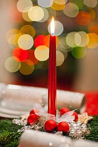 bokeh photography of red candle